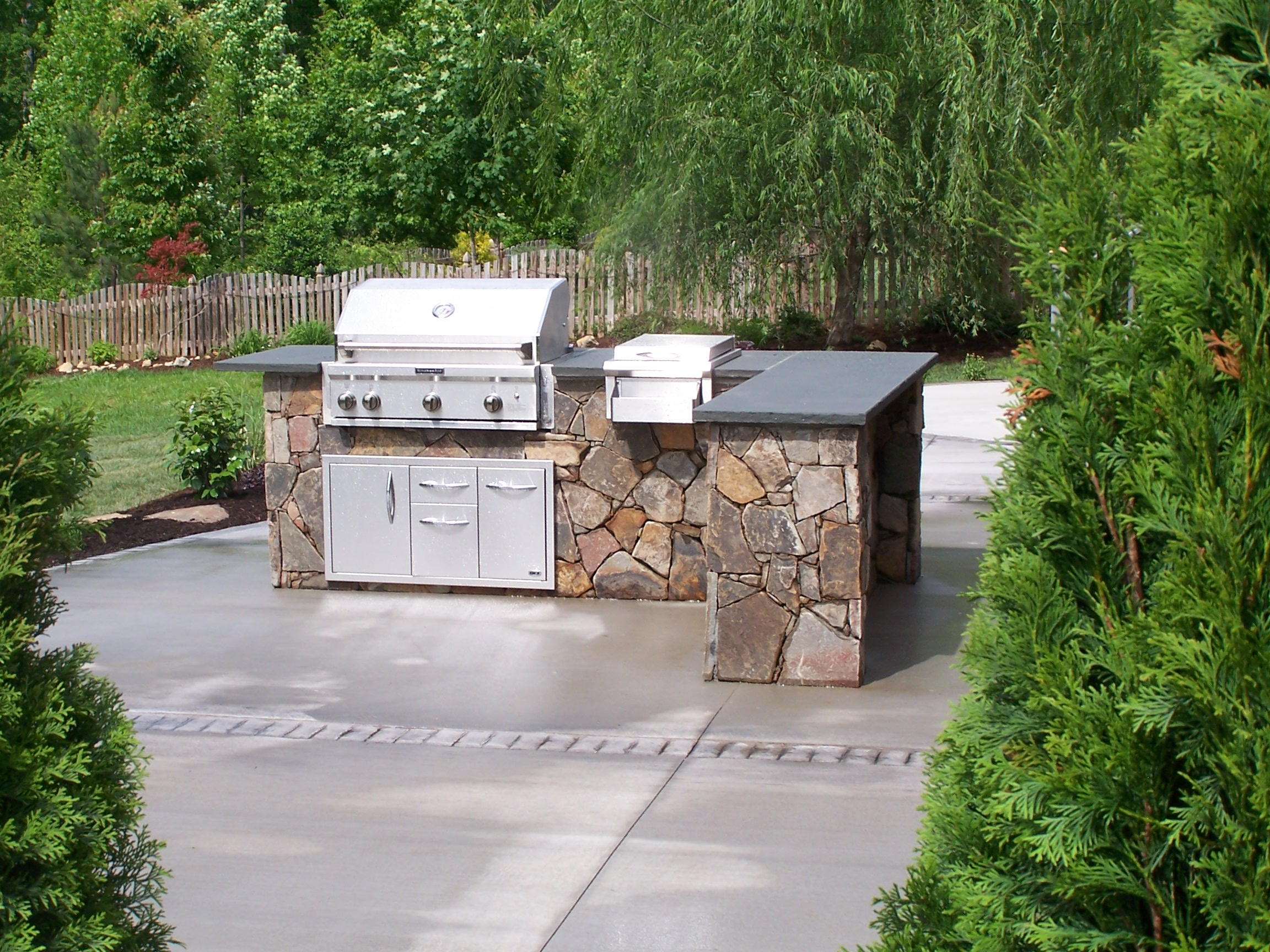 Outdoor kitchen design we build decks sunrooms for Design your outdoor kitchen